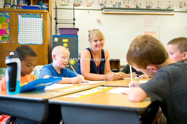 Bethlehem, CT- 27 August 2015-082715CM02- Michelle Tcsheppe, a second grade teacher at Bethlehem Elementary School, chats with students, including Ezra Scibek, (blue shirt), during the first day of school at Bethlehem Elementary School on Thursday.  Christopher Massa Republican-American