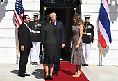 United States President Donald J. Trump (C) greets Naraporn Chan-o-Cha, spouse of Thailand's Prime Minister Prayut Chan-o-cha (L) as he and First Lady Melania Trump welcome them to the White House, Washington, DC, October 2, 2017.                <br /> Credit: Mike Theiler / CNP