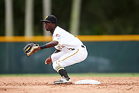 GCL Pirates shortstop Victor Ngoepe (5) waits for a throw during a game against the GCL Phillies on August 6, 2016 at Pirate City in Bradenton, Florida.  GCL Phillies defeated the GCL Pirates 4-1.  (Mike Janes/Four Seam Images)