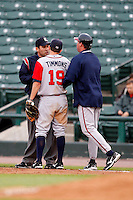 June 3, 2009:  Manager Dave Brundage of the Gwinnett Braves pushes first baseman Wes Timmons out of the way to argue a call with first base umpire Manuel Gonzalez during a game at Frontier Field in Rochester, NY.  The Gwinnett Braves are the International League Triple-A affiliate of the Atlanta Braves.  Photo by:  Mike Janes/Four Seam Images