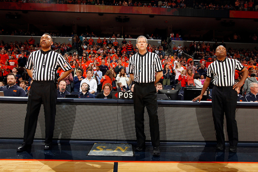 ACC referees wait for the game to begin Saturday, February 22, 2014,  in Charlottesville, VA. Virginia defeated Notre Dame 70-49.