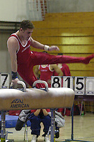 6 January 2001: Justin Berkman on the pommel horse during a meet at Burnham Pavilion in Stanford, CA
