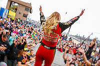 Feb 26, 2017; Chandler, AZ, USA; NHRA top fuel driver Leah Pritchett walks onto the stage during driver introductions for the Arizona Nationals at Wild Horse Pass Motorsports Park. Mandatory Credit: Mark J. Rebilas-USA TODAY Sports
