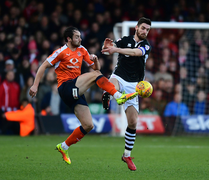 Lincoln City's Luke Waterfall vies for possession with Luton Town's Danny Hylton<br /> <br /> Photographer Chris Vaughan/CameraSport<br /> <br /> The EFL Sky Bet League Two - Luton Town v Lincoln City - Monday 1st January 2018 - Kenilworth Road - Luton<br /> <br /> World Copyright &copy; 2018 CameraSport. All rights reserved. 43 Linden Ave. Countesthorpe. Leicester. England. LE8 5PG - Tel: +44 (0) 116 277 4147 - admin@camerasport.com - www.camerasport.com