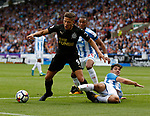 Christopher Schindler of Huddersfield Town tackles Dwight Gayle of Newcastle United during the premier league match at the John Smith's Stadium, Huddersfield. Picture date 20th August 2017. Picture credit should read: Simon Bellis/Sportimage