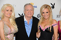 "Playboy Magazine founder Hugh Hefner poses with ""The Girls Next Door"" stars Holly Madison, left, and Bridget Marquardt at Playboy's ninth annual ""Super Saturday Night""  party in at Playboy's Desert Oasis and Resort in Chandler, Arizona Saturday February 2, 2008.   (Photo by Alan Greth)"