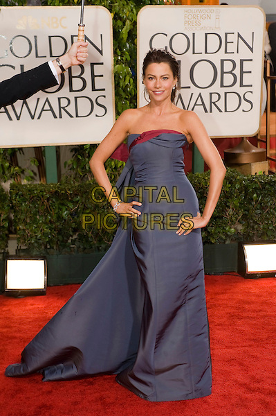 SOFIA VERGARA.Arrivals at the 67th Golden Globe Awards held Beverly Hilton, Beverly Hills, California, USA..January 17th, 2010.globes full length strapless blue dress train hands on hips red sophia long maxi  viagra .CAP/AW/HFPA.Supplied by Anita Weber/Capital Pictures