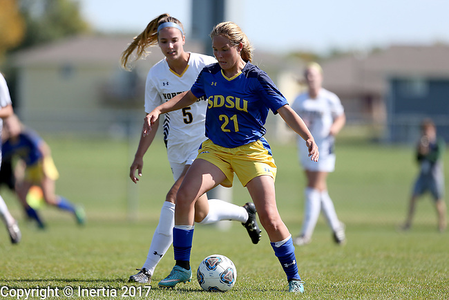 BROOKINGS, SD - SEPTEMBER 17:  Tori Poole #21 from South Dakota State University controls the ball in front of Courtney Elterman #5 from Northern Colorado during their game Sunday afternoon at Fischback Soccer Field in Brookings. (Photo by Dave Eggen/Inertia)
