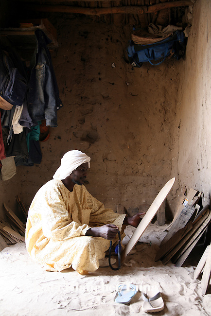 A marabout in his house in Timbuctu, Mali. He uses wooden boards to write versets and teach read to pupils. The coranic schools in Timbuctu are only open early in the morning and on Saturdays in order to allow pupils to attend the public school.