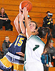 Helena Salmon #15 of Massapequa, left, draws a foul during a Nassau County varsity girls basketball game against host Farmingdale High School on Saturday, Jan. 28, 2017. She scored 24 points to lead the Lady Chiefs to a 47-44 win in overtime.