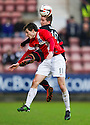 Pars' Josh Falkingham and Ayr Utd's Michael Donald challenge for the ball.
