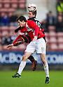 Pars' Josh Falkingham and Ayr Utd's Michael Donald challenge for the ball.