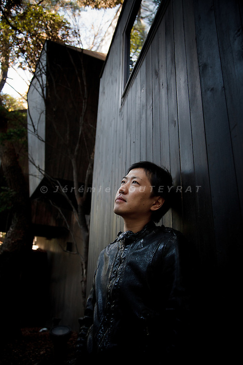 """Tokyo, December 9 2010 - Portrait of the architect Hiroshi Nakamura (NAP) in front of the """"dancing trees, singing birds"""" appartment building that he created in 2008 in the center of Tokyo."""