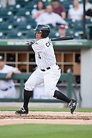 Everth Cabrera (4) of the Charlotte Knights follows through on his swing against the Durham Bulls at BB&T BallPark on May 15, 2017 in Charlotte, North Carolina. The Knights defeated the Bulls 6-4.  (Brian Westerholt/Four Seam Images)