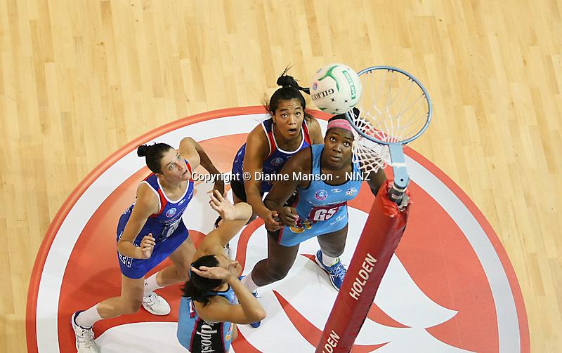 Steel's Jodi Brown, left,  takes a shot at goal in the ANZ championship netball match, Steel v Mystics, ILT Stadium Southland, Invercargill, New Zealand, Sunday, April 6, 2014. Photo: Dianne Manson