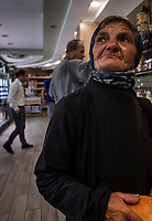 Albania. Gjirokastër. An elderly Romani woman is begging for food inside a shop.The Romani (also spelled Romany) or Roma, Roms or Gypsies, are a traditionally itinerant ethnic group. Gypsies, Gjirokastër is a city in southern Albania. 23.05.2018 © 2018 Didier Ruef