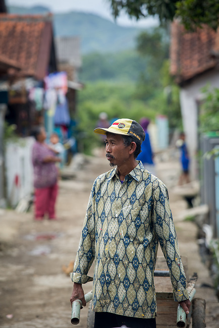 29 JAN, 2018, Bandung, Indonesia: Akhyar, the head of  Pangkalan village, Cihaur sub district, West Bandung commenting on the health problems of residents as a result of river pollution. The Citarum river in West Java, Indonesia is listed as one of the most polluted rivers in the world.  It will soon be the main water supply system for Jakarta as the bores that have been dug into the aquifers dry but it also supports agriculture, fishery, industry, sewerage and electricity.      Picture by Graham Crouch/The Australian