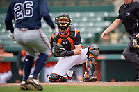 GCL Orioles catcher Jordan Cannon (35) looks to tag Michael Harris (26) out at home during a Gulf Coast League game against the GCL Braves on August 5, 2019 at Ed Smith Stadium in Sarasota, Florida.  GCL Orioles defeated the GCL Braves 4-3 in the first game of a doubleheader.  (Mike Janes/Four Seam Images)