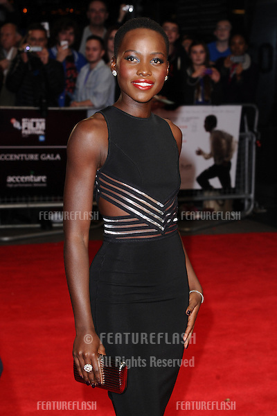 "Lupita Nyong'o arrives for the premiere of ""12 Years a Slave"" which is being screened at the Odeon Leicester Square as part of the bfi London Film Festival 2013, London. 18/10/2013 Picture by: Steve Vas / Featureflash"