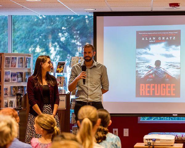 July 26, 2017. Raleigh, North Carolina.<br /> <br /> Rachael Borowy and Ryan Smith of the US Committee for Refugees and Immigrants spoke to the crowd before Alan Gratz's author's talk. <br /> <br /> Author Alan Gratz spoke about and signed his new book &quot;Refugee&quot; at Quail Ridge Books. The young adult fiction novel contrasts the stories of three refugees from different time periods, a Jewish boy in 1930's Germany , a Cuban girl in 1994 and a Syrian boy in 2015.