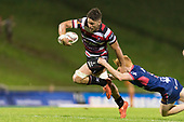 Sam Henwood looks to break free from Finlay Christie's tackle. Mitre 10 Cup game between Counties Manukau Steelers and Tasman Mako's, played at ECOLight Stadium Pukekohe on Saturday October 14th 2017. Counties Manukau won the game 52 - 30 after trailing 22 - 19 at halftime. <br /> Photo by Richard Spranger.