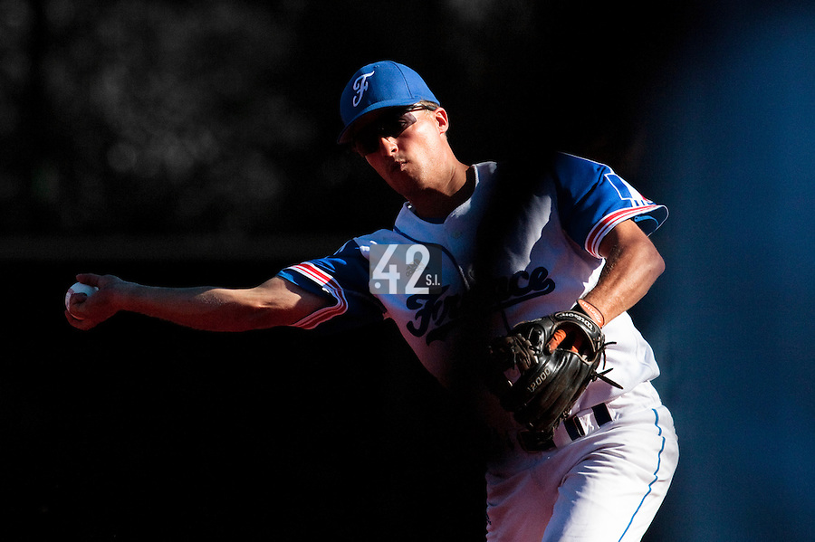 18 July 2010: Romain Scott Martinez of Team France throws the ball to first base during day 6 of the Open de Rouen, an international tournament with Team France, Team Saint Martin, Team All Star Elite, at Stade Pierre Rolland, in Rouen, France.
