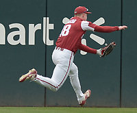 NWA Democrat-Gazette/ANDY SHUPE<br />Arkansas left fielder Heston Kjertad makes a leaping catch Saturday, April 14, 2018, during the second inning against South Carolina at Baum Stadium. Visit nwadg.com/photos to see more photographs from the game.