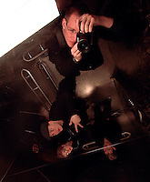 Self portrait in elevator ceiling.