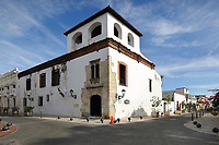 Museo Casa de Tostado, built 14th century, one of the oldest houses in Santo Domingo, named after its first owner, Francisco Tostado de la Pena, scribe of the governor, in the Colonial Zone of Santo Domingo, capital of the Dominican Republic, in the Caribbean. The house was originally a luxurious mansion, and now houses the Museo de la Familia Dominicana del siglo XIX, or Museum of the Dominican Family of the 19th Century. On the corner is an Elizabethan Gothic window, the one one in the Americas. Santo Domingo's Colonial Zone is listed as a UNESCO World Heritage Site. Picture by Manuel Cohen