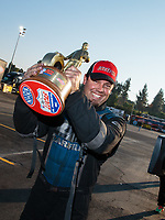 Nov 11, 2018; Pomona, CA, USA; NHRA top alcohol funny car driver Shane Westerfield celebrates after winning the Auto Club Finals at Auto Club Raceway. Mandatory Credit: Mark J. Rebilas-USA TODAY Sports