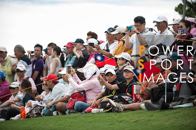 TAOYUAN, TAIWAN - OCTOBER 28:  Spectators cheer on the 2nd hole during the day four of the Sunrise LPGA Taiwan Championship at the Sunrise Golf Course on October 28, 2012 in Taoyuan, Taiwan.  Photo by Victor Fraile / The Power of Sport Images