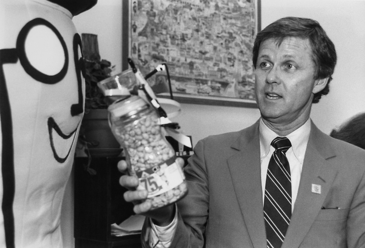 Rep. Lindsay Thomas, D-Ga., receives a jar of peanuts from Mr. Peanut in celebration of Mr. Peanut's 75th birthday and National Peanut Month on March 21, 1991. (Photo by Jamie Howren/ CQ Roll Call)
