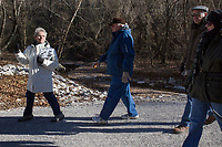 NWA Democrat-Gazette/CHARLIE KAIJO Tour guide  Diane Gately (from left) walks hikers Jim Sawyer of Rogers and Tim and Stephanie Ensley of Bella Vista during a hike on Monday, January 1, 2018 at the Van Winkle sawmill trail in Rogers.<br />