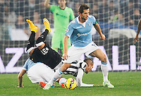 Senad Lulic  and  Roberto Pereyra   in action during the Italian Serie A soccer match between   SS Lazio and FC Juventus   at Olimpico  stadium in Rome , November 22, 2014