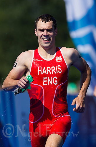 24 JUL 2014 - GLASGOW, GBR - Aaron Harris (ENG) from England heads for transition at the end of the swim at the elite men's 2014 Commonwealth Games triathlon  in Strathclyde Country Park, in Glasgow, Scotland (PHOTO COPYRIGHT &copy; 2014 NIGEL FARROW, ALL RIGHTS RESERVED)<br /> *******************************<br /> COMMONWEALTH GAMES <br /> FEDERATION USAGE <br /> RULES APPLY<br /> *******************************