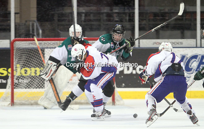 Cherry Creek's Kody Poon (25), Richard Torres (17) and Medina's Liam Foreit (5). Medina (Ohio) 5-1 on the third day of pool play during the 2014 High School Hockey National Championship in Omaha on March 28. (Photo by Michelle Bishop)