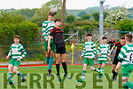 Liam Curran(Killarney Celtic) in action with John ward in the Healy Cup Final at Mounthawk Park,Tralee on Saturday