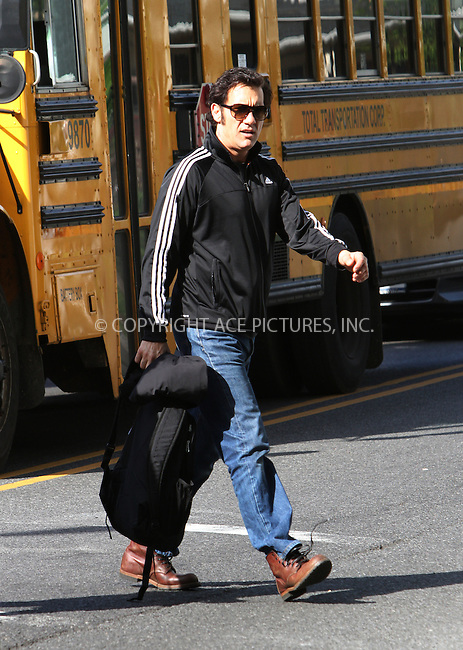 WWW.ACEPIXS.COM . . . . .  ....May 17 2012, New York City....Actor Clive Owen walks on the Brooklyn set of the new movie 'Blood Ties' on May 17 2012 in New York City....Please byline: Zelig Shaul - ACE PICTURES.... *** ***..Ace Pictures, Inc:  ..Philip Vaughan (212) 243-8787 or (646) 769 0430..e-mail: info@acepixs.com..web: http://www.acepixs.com