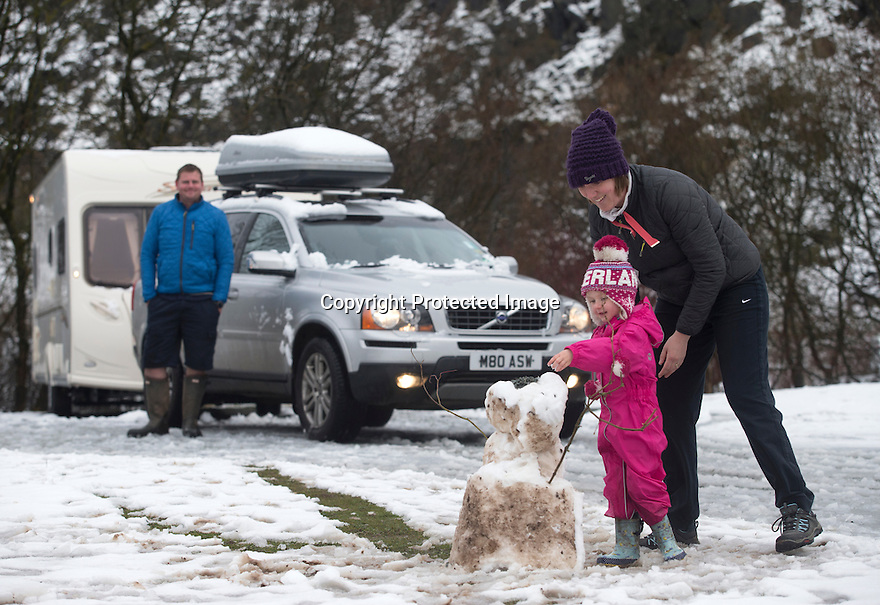 """28/03/16 <br /> <br /> Greta Williams (3) with her Aunty Claire Jones.<br /> <br /> Holiday makers camping in the Derbyshire Peak District woke up to an unexpected white blanket this morning, thanks to Storm Katie.<br /> The covering of snow meant that many campers cut short their plans for a long weekend away, to brave the icy roads and head home early on Monday morning.<br /> But it wasn't all bad news for some of the younger guests at Grin Low Caravan Site in Buxton.<br /> Three-year-old Greta Williams made the most of the morning's surprise by building a snowman and enjoying snowball fights with her aunt Claire Jones. <br /> Claire said it was the first time she had been camping in the snow. <br /> """"It was completely unexpected but it's made it a trip to remember,""""she said. <br /> """"Greta really enjoyed making the snowman, but I think we'll head back home now in case any more falls.""""<br /> For Chris and Lorraine McCoy the first they knew of the snow was when they woke up and stuck their heads out of their tent.<br /> They had travelled to Buxton from Warwickshire with their four-year-old son Joe, to enjoy a weekend break.<br /> """"It's all part of the adventure,"""" said Chris. """"It's a bit cold in the tent but we'll soon warm up, and it's made the surrounding countryside really beautiful.""""<br /> <br /> All Rights Reserved: F Stop Press Ltd. +44(0)1335 418365   +44 (0)7765 242650 www.fstoppress.com"""