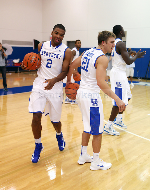 Aaron Harrison running around Tod Lanter during basketball photo media day in Lexington, Ky., on Thursday, September 12, 2013. Photo by Eleanor Hasken l Staff