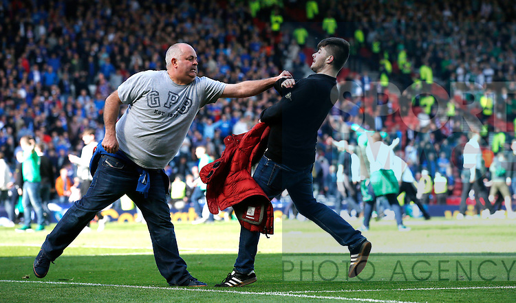 Fans and police on the pitch after the William Hill Scottish Cup Final match at Hampden Park Stadium.  Photo credit should read: Lynne Cameron/Sportimage<br /> --------------------<br /> Sport Image<br /> 15/16 Rangers v Hibernian<br /> <br /> 21 May 2016<br /> &copy;2016 Sport Image all rights reserved