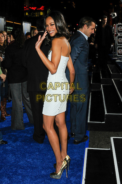 "ZOE SALDANA.The Los Angeles premiere of ""Avatar"" at Grauman's Chinese Theatre in Hollywood, California, USA..December 16th, 2009.full length silver gold strapless dress shiny white sides platform shoes metallic studs studded back behind rear looking over shoulder hand waving .CAP/ROT.©Lee Roth/Capital Pictures"