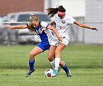 Roxana player Olivia Mouser (left) and Wesclin player Galena Stewart fight for the ball in the first half. Roxana High School defeated Wesclin High School 3-2 to win the Class 1A Girls Soccer Regional at Breese Central High School on Friday May 11, 2018. Tim Vizer | Special to STLhighschoolsports.com