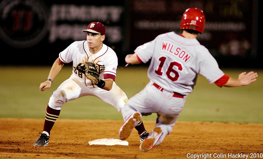 TALLAHASSEE, FL 5/14/10-FSU-NC STATE BASE10 CH-Florida State's Stephen Cardullo waits on a throw as N.C. State's Kyle Wilson slides Friday at Dick Howser Stadium in Tallahassee. The Wolfpack downed the Seminoles 5-2...COLIN HACKLEY PHOTO