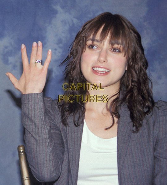 KEIRA KNIGHTLEY.headshot, portrait, Kiera Knightly, fringe, bangs, hand, ring, gesture.www.capitalpictures.com.sales@capitalpictures.com.Supplied By Capital Pictures.