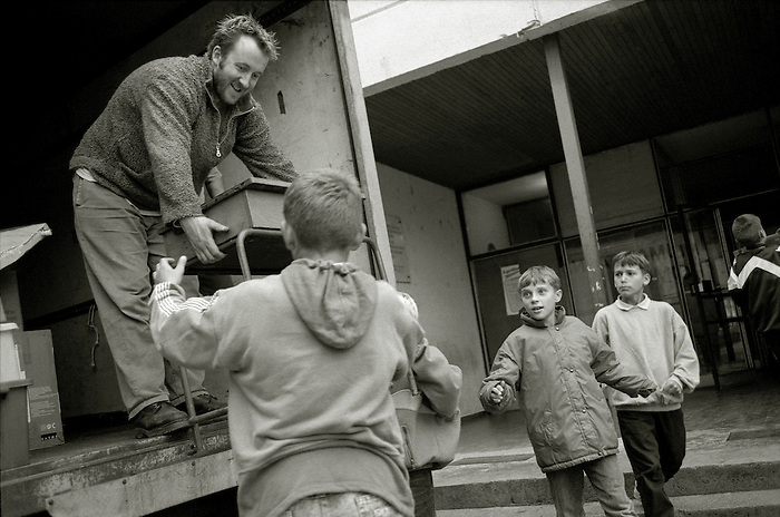 A delivery of donated school desks to a village school in North West Bosnia. This area suffered greatly from 'ethnic cleansing' in the war.