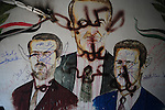 ALEPPO: August 3rd 2012:..Defaced portrait of the the Assad clan in a captured police station in Aleppo..Ayman Oghanna for The Sunday Telegraph.