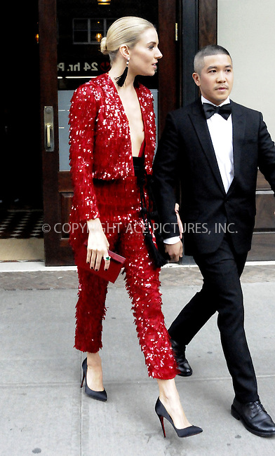 WWW.ACEPIXS.COM<br /> <br /> May 4 2015, New York City<br /> <br /> Actress Sienna Miller leaves a dowbtown hotel on her way to the Met Gala on May 4 2015 in New York City<br /> <br /> By Line: Curtis Means/ACE Pictures<br /> <br /> <br /> ACE Pictures, Inc.<br /> tel: 646 769 0430<br /> Email: info@acepixs.com<br /> www.acepixs.com