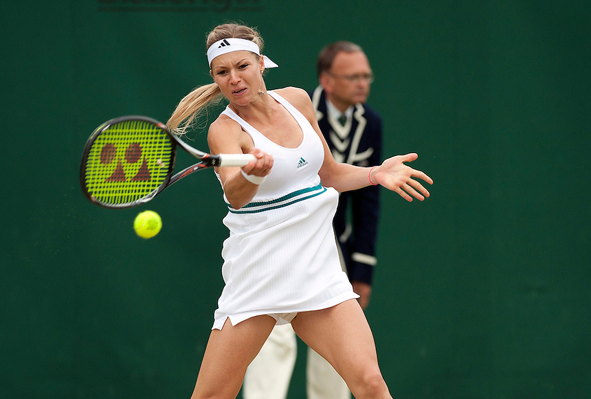 Maria Kirilenko RUS (17) in action today during her victory over Shuai Peng CHN (30) in their Ladies' Singles Fourth Round match - Maria Kirilenko RUS (17) def Shuai Peng CHN (30) 6-1 6-7(6) 6-3..Tennis - Wimbledon Lawn Tennis Championships - Day 7 - Monday 2nd July 2012 -  All England Lawn Tennis and Croquet Club - Wimbledon - London - England...