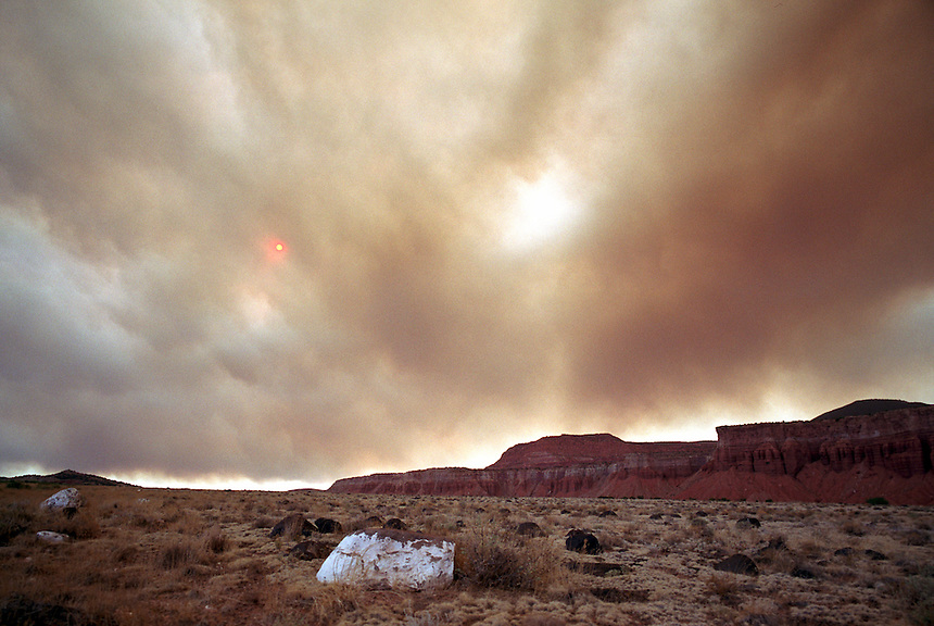A pall of smoke from Utah's Big Wash fire, centered near Zion National Park, obscures the sun a hundred miles away near Capitol Reef National Park Saturday, June 8, 2002. The 5,000 acre fire is one of many burning across the west where drought conditions aggravate fire fighting efforts.
